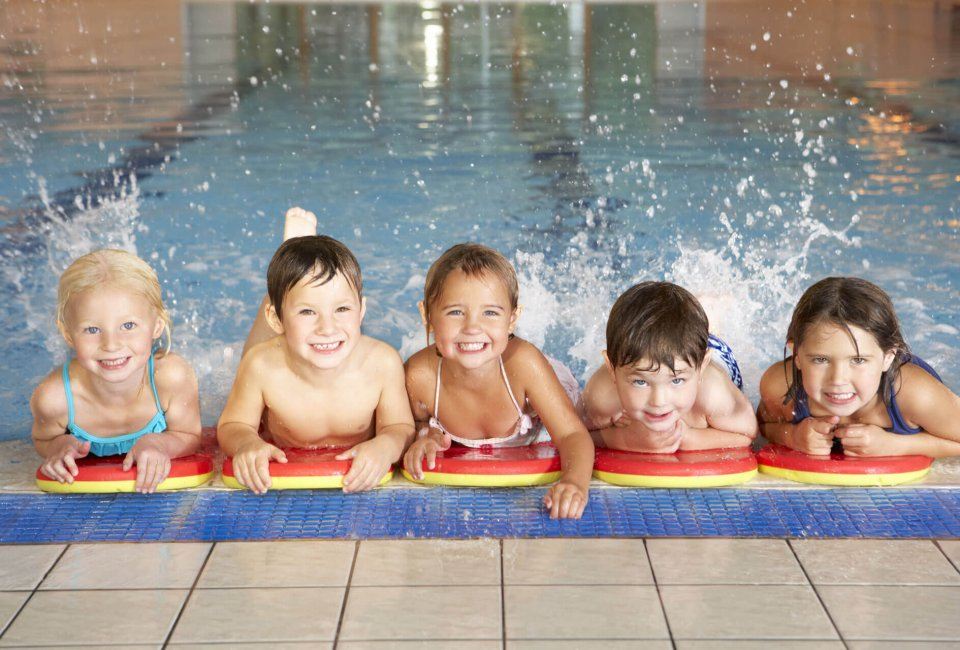 kids splashing and having fun in the pool