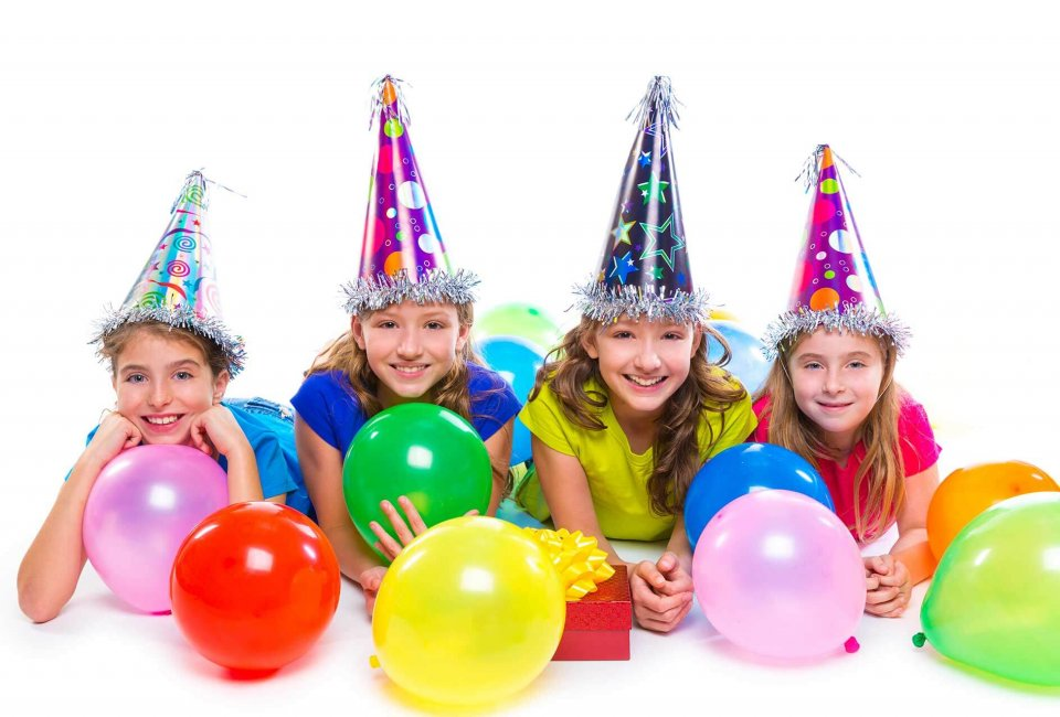 kids wearing party hats enjoying a birthday party