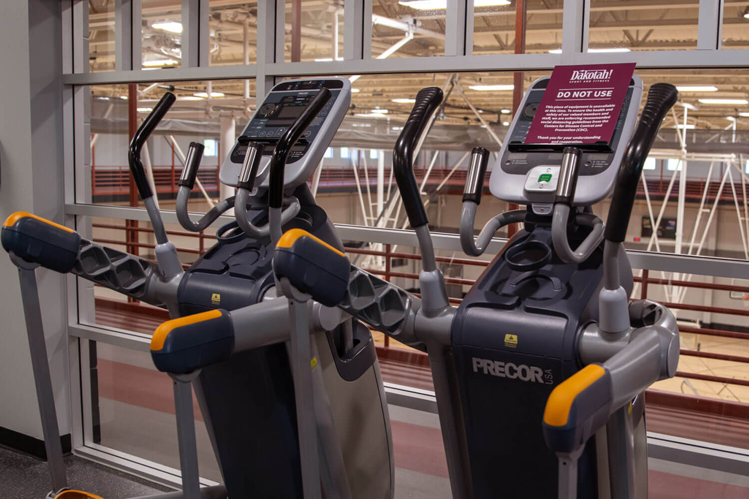 Work out machines with signage for proper spacing during COVID-19